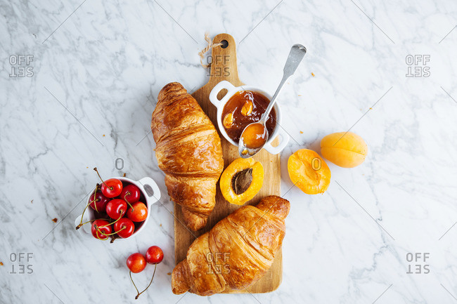 Croissants, apricots, cherries and homemade apricot jam