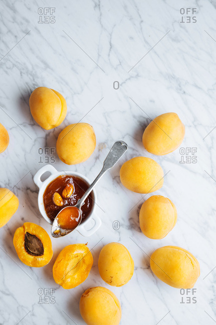 Apricots with a jar of homemade apricot jam