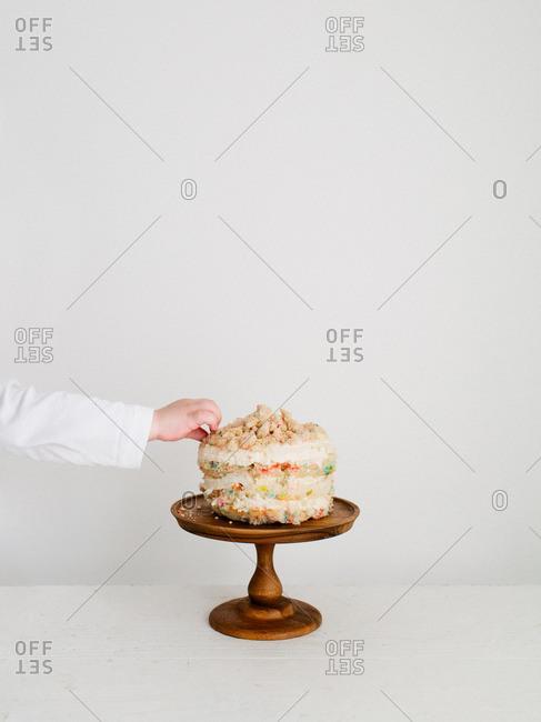 Little Hand Grabbing Cake