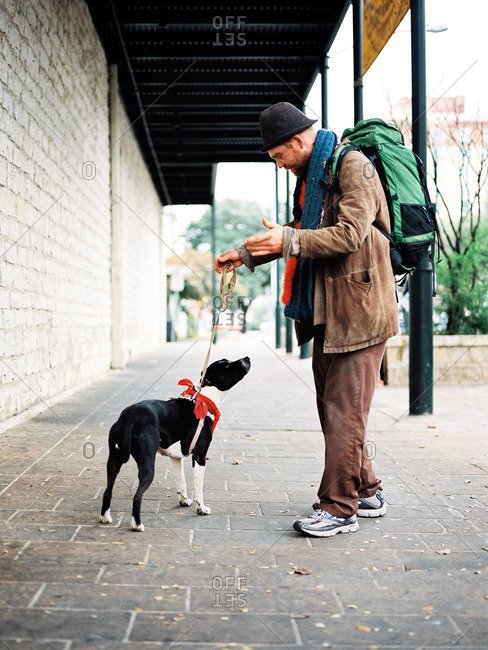 New York, NY - 1/30/13: Homeless Man with Dog