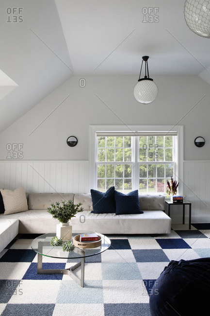 White living room with checkered carpet