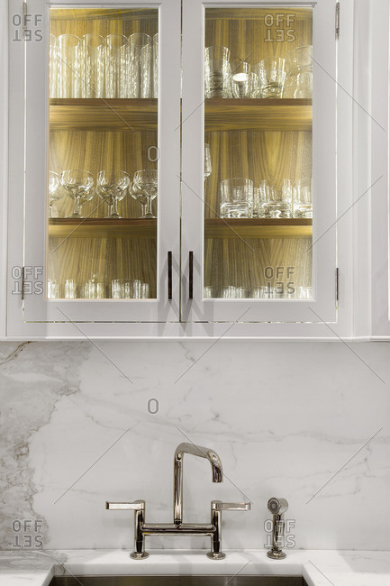 Glasses stored in glass cabinet