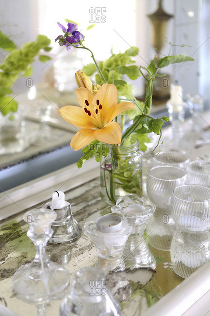 Still life of flowers and glassware