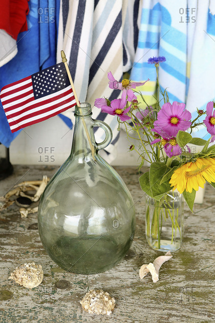 Miniature American flag in glass jug