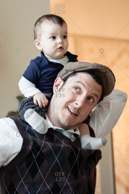 Portrait of father holding baby on his shoulders