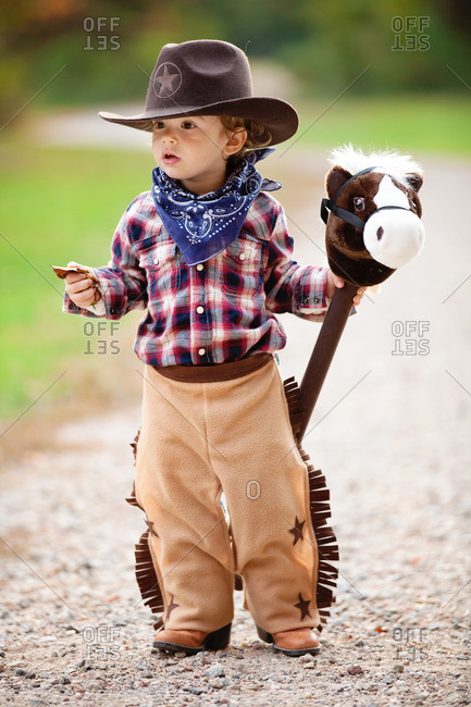 Little boy dressed as a cowboy for Halloween