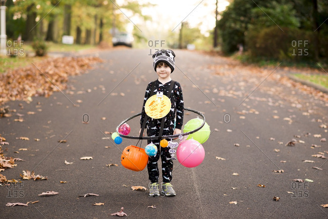Portrait of a little boy dressed as a solar system for Halloween