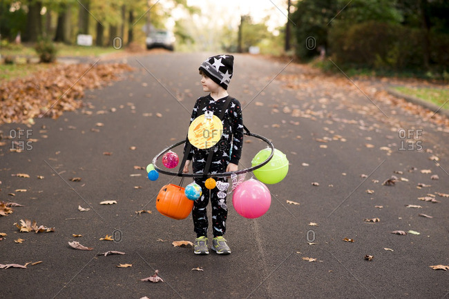 Little boy dressed as a solar system for Halloween