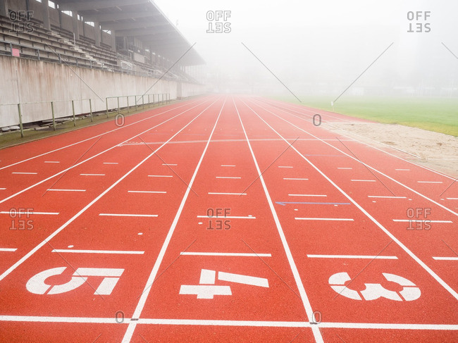 Empty running track on a foggy day