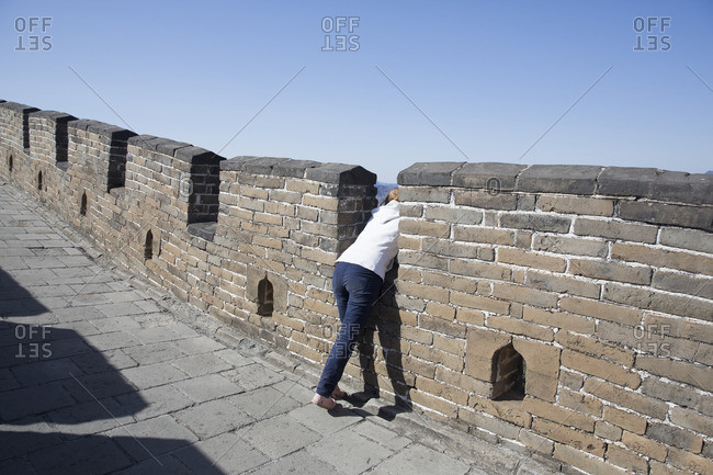 Woman taking in the view from the Mutianyu section of the Great Wall of China