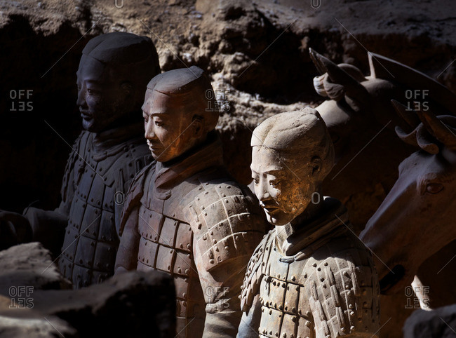 Xi'an, China - March 26, 2016: Warrior statues of the Terracotta Army in the ground