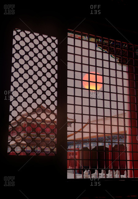 Sunrise seen through window screens at the Forbidden City, Beijing, China