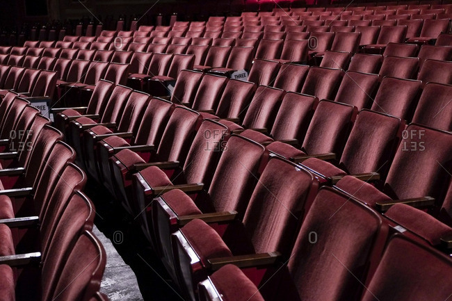 Rows of red theatre seats at a vintage movie palace