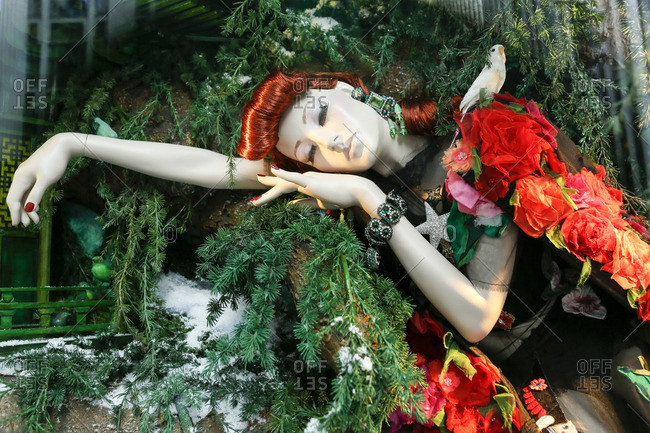 New York City, United States - December 6, 2016: Mannequin in a store window Christmas display