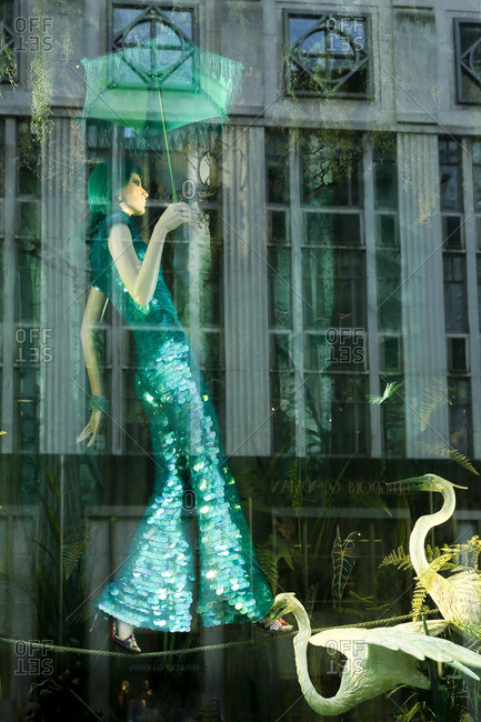 New York City, United States - December 6, 2016: Mannequin on a tightrope in a store window display