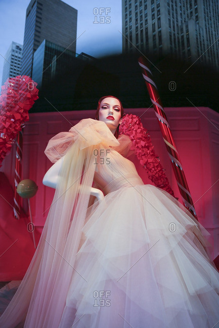New York City, United States - December 6, 2016: Mannequin in a pink dress in a store window display
