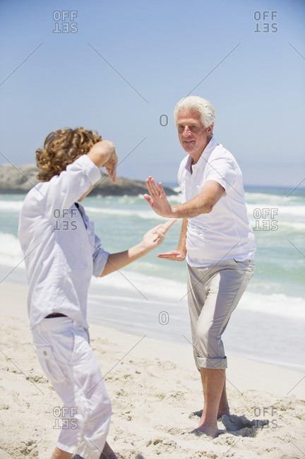 Senior man teaching martial arts to his grandson