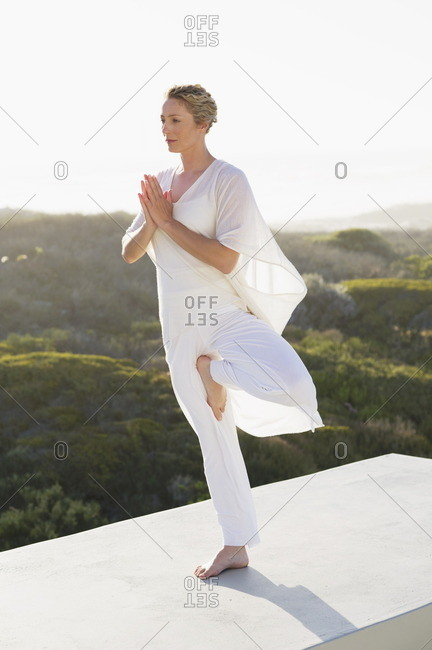 Mid adult woman practicing yoga