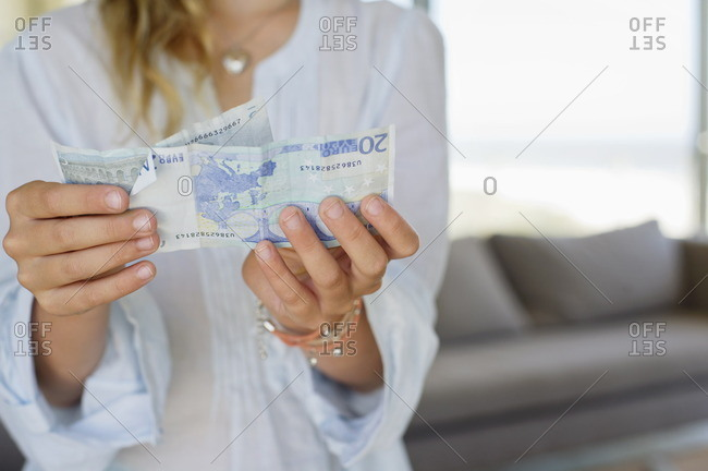 Mid section view of a girl holding paper currency