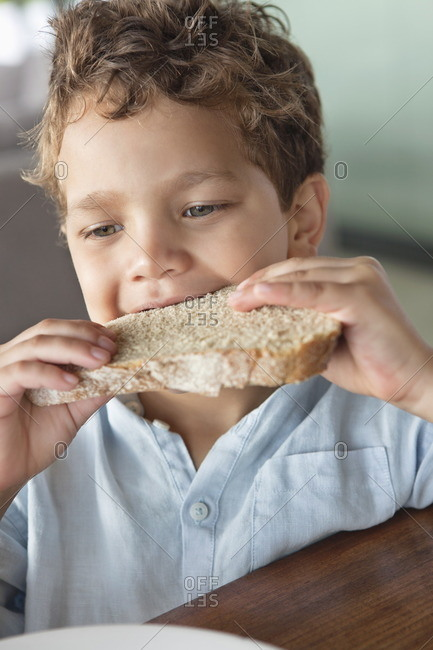 Close-up of a boy eating bread