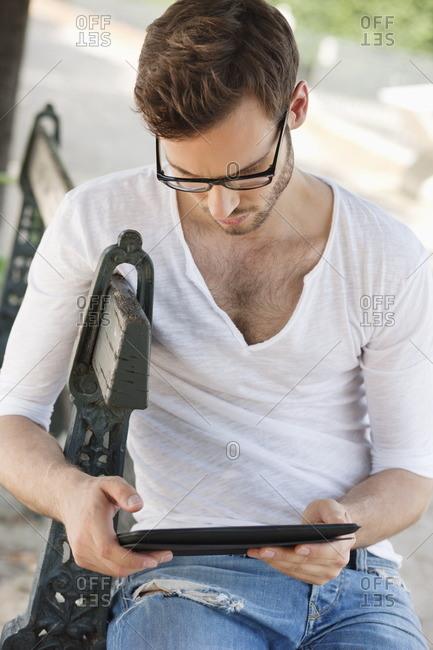 Man using a digital tablet, Paris, Ile-de-France, France