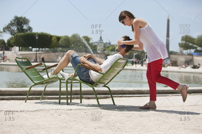 Woman covering eyes of a man with her hands, Bassin octagonal, Jardin des Tuileries, Paris, Ile-de-France, France