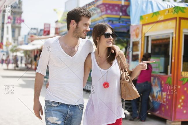 Couple walking in amusement park, Jardin des Tuileries, Paris, Ile-de-France, France