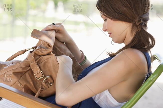 Woman checking her purse, Paris, Ile-de-France, France