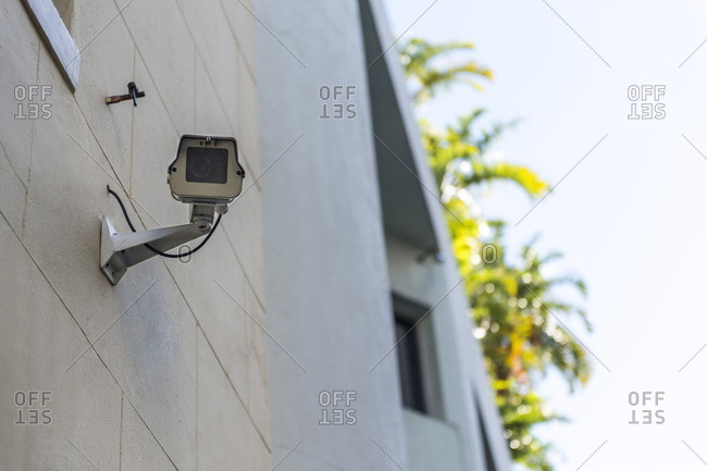 Low angle view of a CCTV camera mounted on a wall