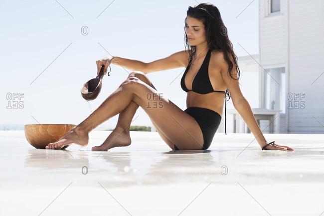 Beautiful woman bathing on the beach