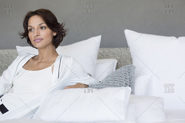 Woman reclining on the bed
