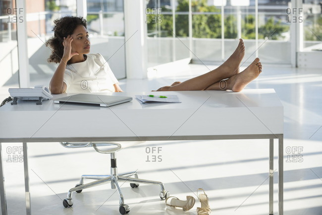 Woman sitting on a chair at home and thinking