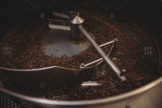 Coffee beans being grinded in coffee grinding machine