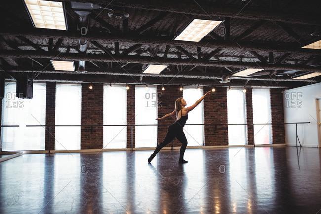 Woman practicing dance in dance studio
