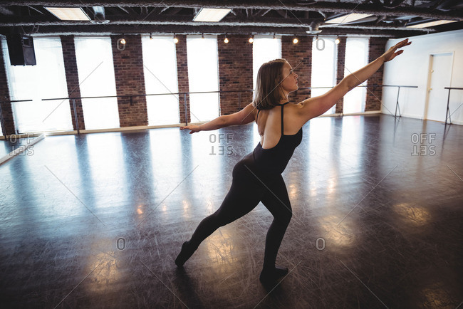 Woman practicing dance in dance studio