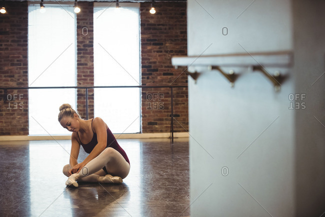 Ballerina wearing ballet shoes in the studio