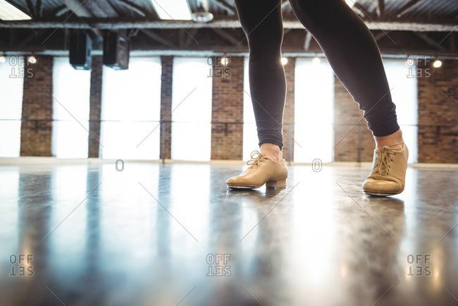 Feet of woman practicing a dance in dance studio