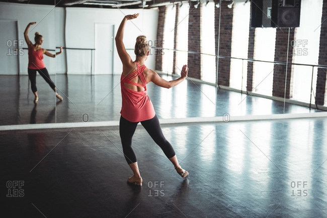 Woman practicing a dance in dance studio