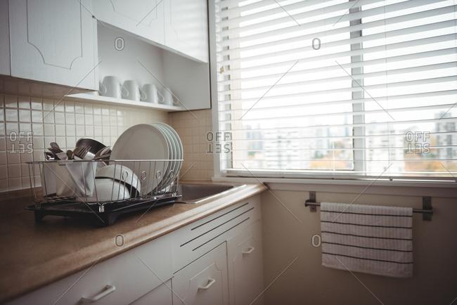 Utensils on kitchen worktop in kitchen at home