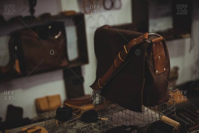 Various leather accessories on table in workshop