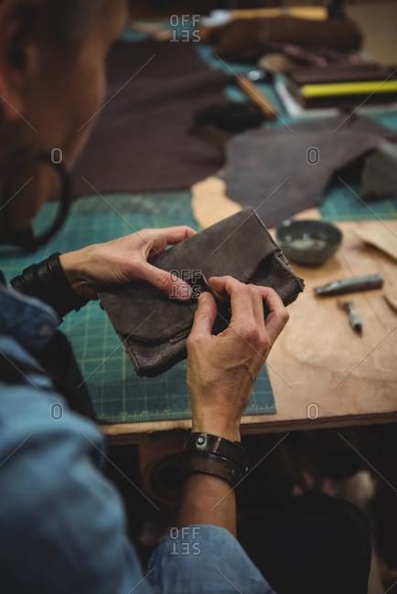 Attentive craftswoman working in workshop