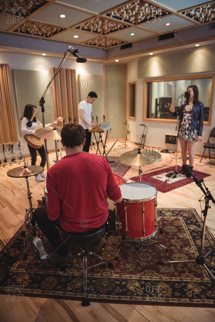 Music band performing in a recording studio