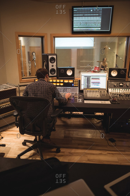 Audio engineer using sound mixer in recording studio
