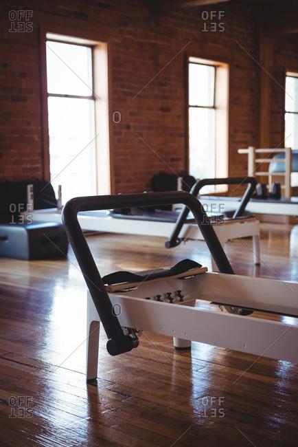 View of reformer in empty fitness studio