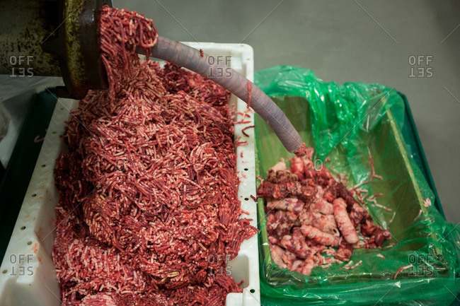 Close-up of meat mincing machine at meat factory