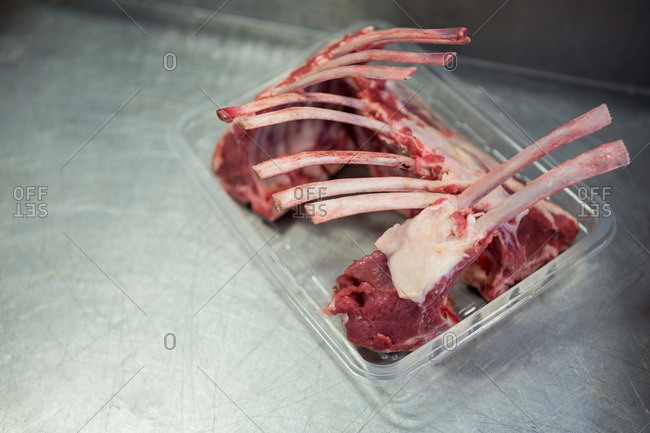 Close-up of raw meat in a plastic packaging tray at meat factory