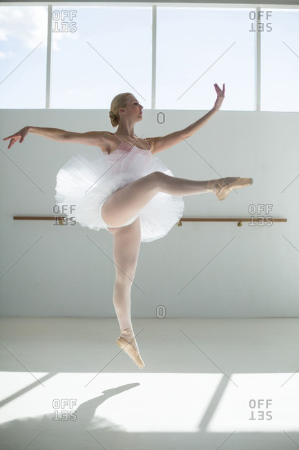 Ballerina practicing a ballet dance in ballet studio