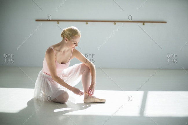 Ballerina wearing ballet shoes in the ballet studio