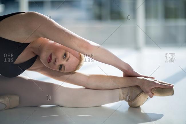 Portrait of ballerina performing a split in the studio