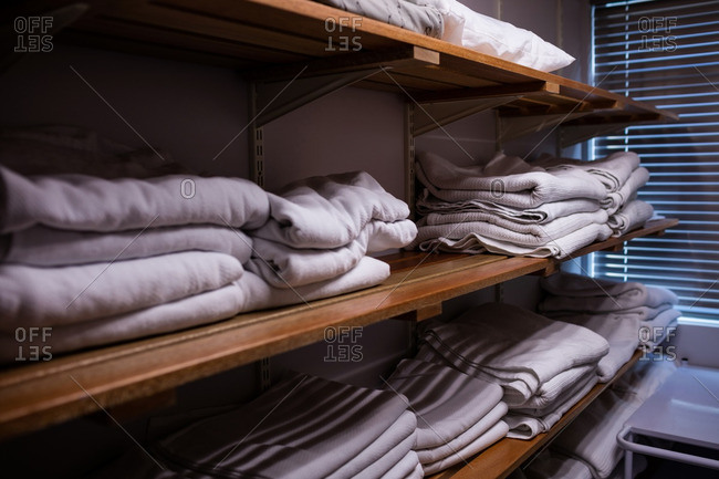 Folded blankets arranged in shelf at hospital